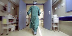 Doctor rushing in hallway